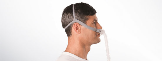 Man wearing nasal pillow CPAP Mask