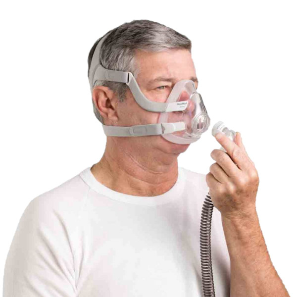 Man Connecting Tube to F20 Mask