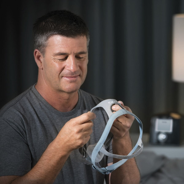 Man Adjusting Eson 2 Headgear