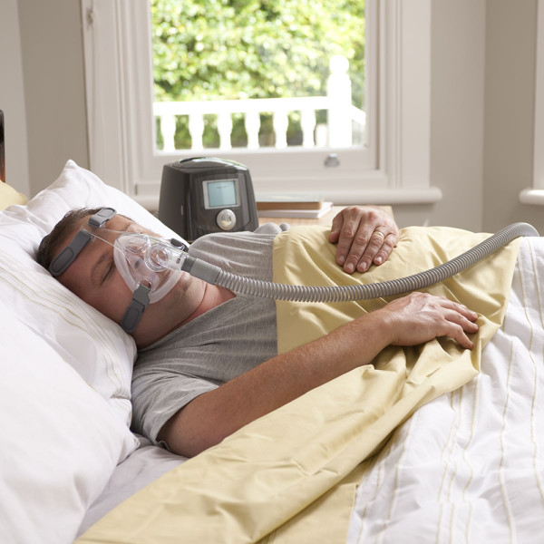 Man Asleep on Bed Wearing Simplus