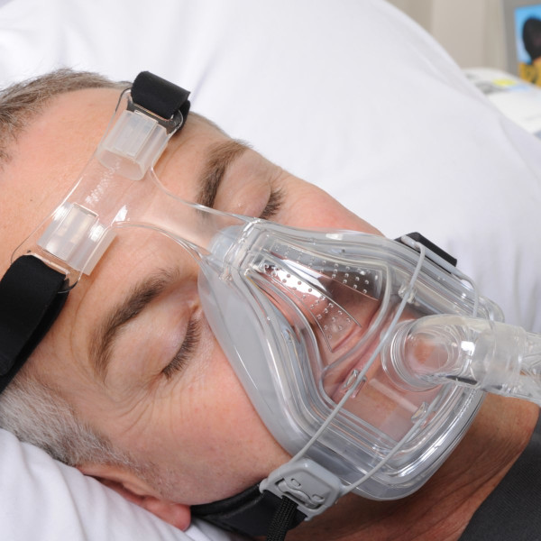 Man Asleep Wearing Forma Mask