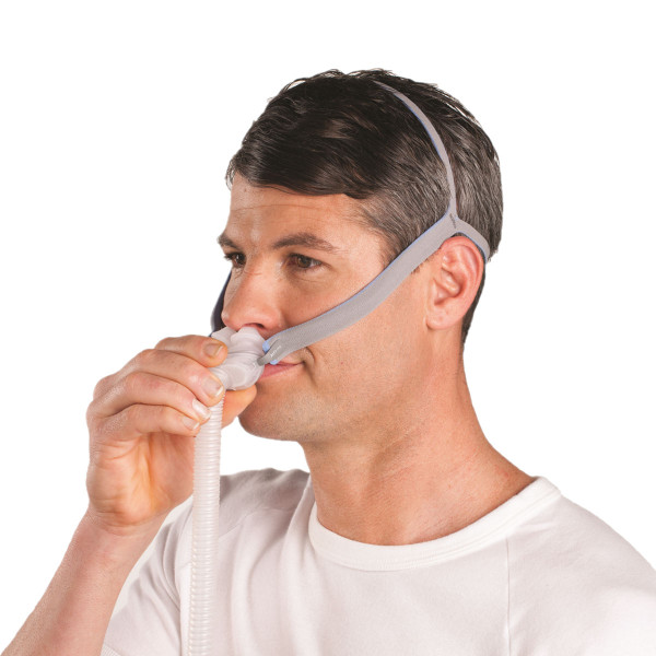 Man Adjusting P10 Nasal Pillow Mask