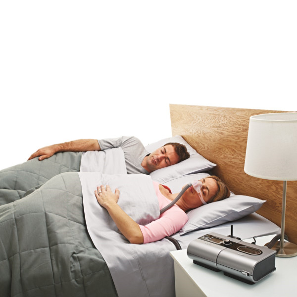 Woman Asleep Wearing ResMed Nano