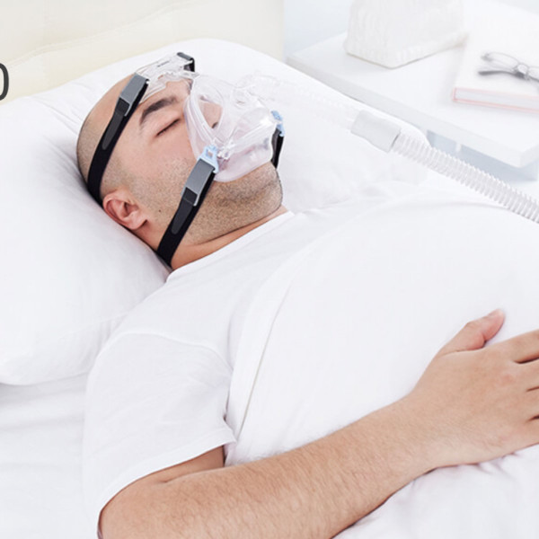 Man Asleep Wearing Wizard 220 Mask