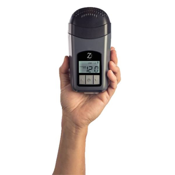 CPAP User Holding Z2 CPAP Machine