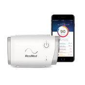 AirMini Travel CPAP Machine next to smartphone