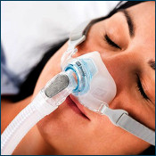 Man holding Nasal Pillow CPAP mask